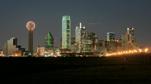 City lights illuminate the Dallas skyline at night Footage