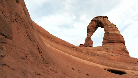 Delicate Arch in Utah's Arches National Park crowns the crest of a red rock ridge Footage