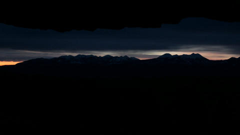 Clouds of darkness lighten into delicate shades of pink... Stock Video Footage