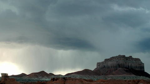 Lightning flashes from storm clouds over Goblin Valley State Park Footage