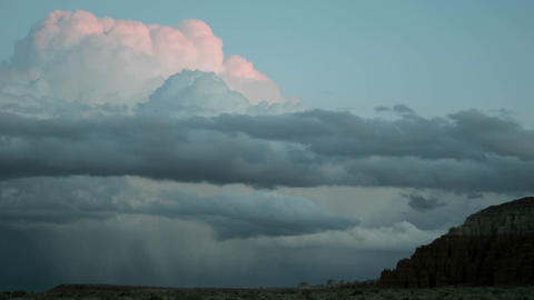 Thunderheads over Goblin Valley State Park take on shades... Stock Video Footage