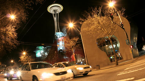 Accelerated traffic stops and then blurs into streaks of light in front of the Seattle Space Needle Footage