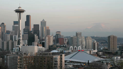 The Seattle Space Needle stands on the left of this time-lapse shot of Seattle's skyline Footage
