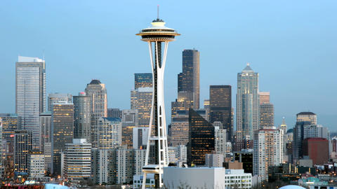 The Seattle Space Needle stands at the center of this time lapse shot of Seattle's skyline Footage