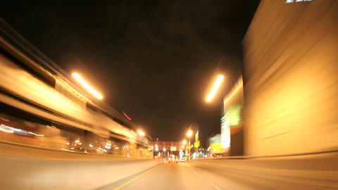 A time lapse shot through a busy downtown city street at night Footage