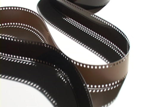 Pan-up along an unrolled spool of film Stock Video Footage