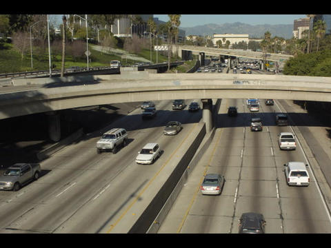 An overhead accelerated shot of freeway traffic and bridges in an urban area Footage