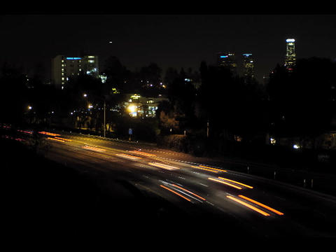 An accelerated view of traffic flowing at night with a... Stock Video Footage