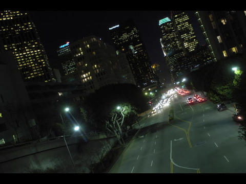 An accelerated aerial view of city traffic at night with... Stock Video Footage