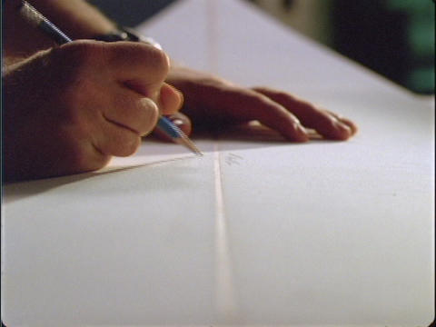 A close-up of a person's hands writing on a white board Stock Video Footage