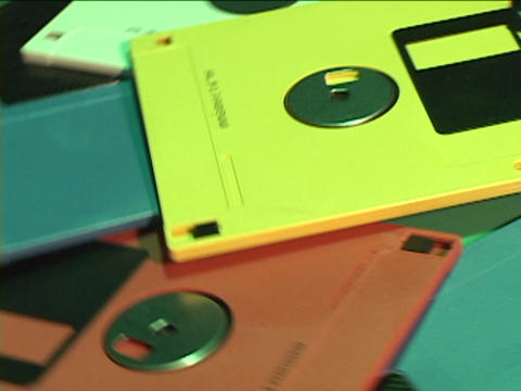 A pile of colorful floppy disks revolves in a circle Stock Video Footage