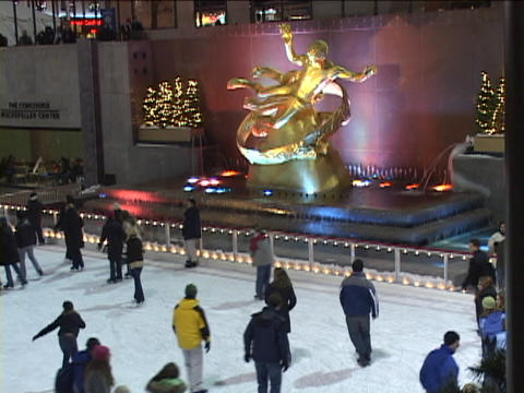 Ice skaters make their way around the Rockefeller Center... Stock Video Footage