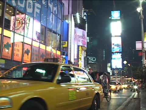 Neon lights light up Times Square, New York at night Footage