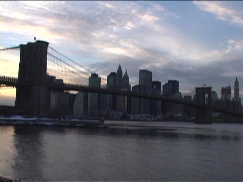 The Brooklyn Bridge overlooks the skyline of New York City Footage