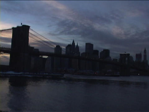 The Brooklyn Bridge overlooks the skyline of New York City Stock Video Footage