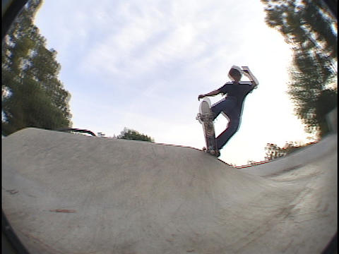 A skateboarder practices at a skate park Footage
