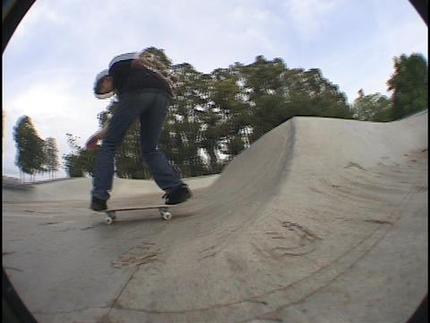 A skateboarder practices at a skate park Stock Video Footage