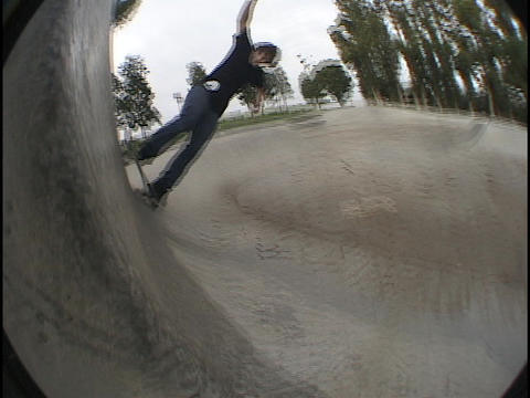 An athlete practices at a skate park Stock Video Footage
