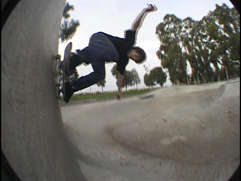 An athlete practices at a skate park Footage