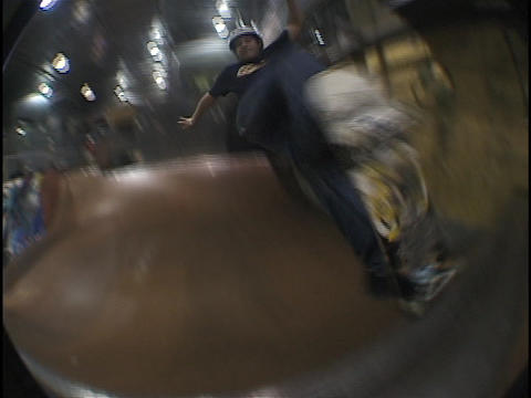 An athlete skateboards on a half-pipe Stock Video Footage