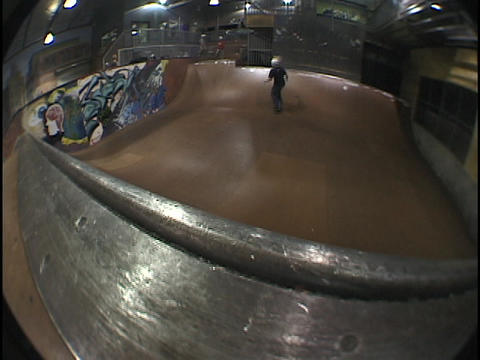 An athlete skateboards on a half-pipe Footage