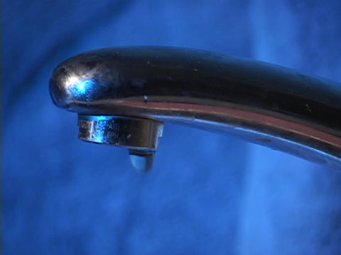Water drips from a faucet Stock Video Footage