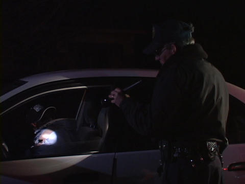 The driver hands over his registration to the policeman... Stock Video Footage