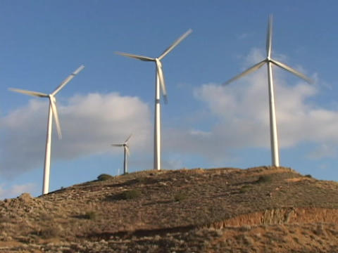Wind Turbines Spin In The Wind stock footage