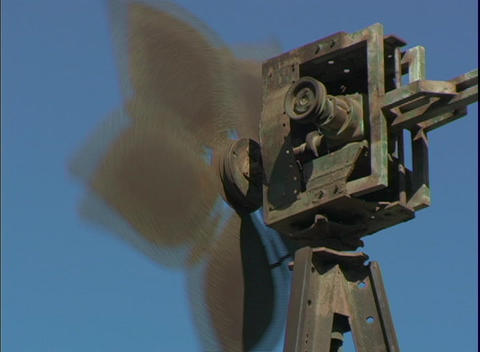 The blades of a windmill turn in the wind Footage