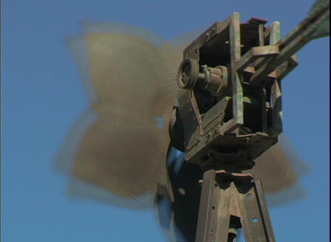 The blades of a windmill turn in the wind Stock Video Footage