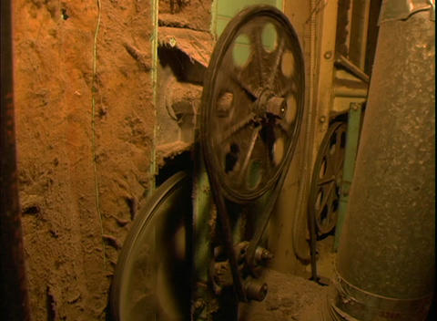 A pulley drives an old wheel Stock Video Footage