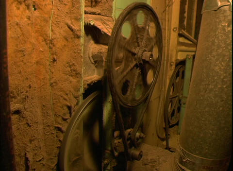 A pulley drives an old wheel Footage