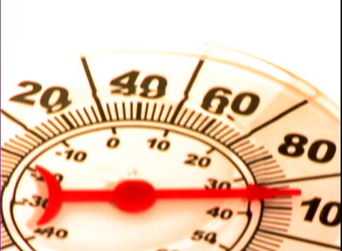 The needle on a thermometer points to around 94 degrees Footage