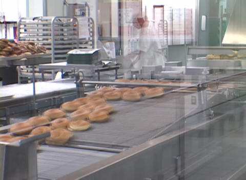 A time-lapse look at a donut shop with workers and donuts... Stock Video Footage