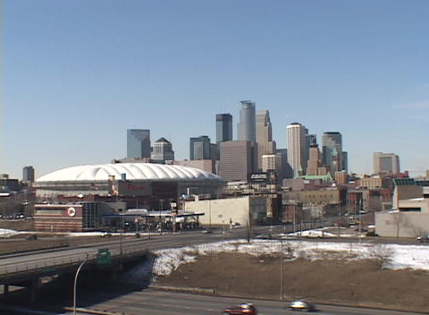 A view of downtown Minneapolis buildings and freeways in winter Footage