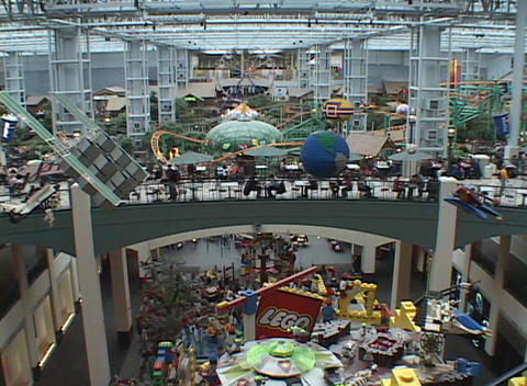 A large shopping mall includes amusement rides and a play... Stock Video Footage