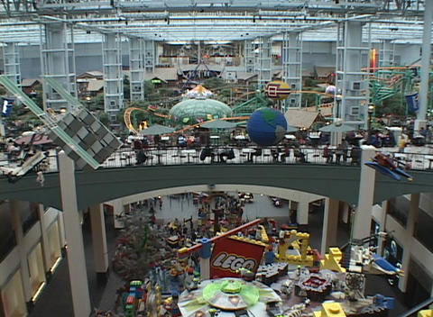 A large shopping mall includes amusement rides and a play area for children Footage