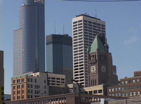 A look at downtown skyscrapers and a clock-tower on a bright sunny day Footage