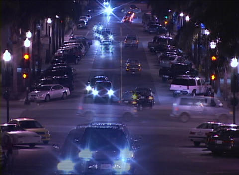 An accelerated shot of traffic and pedestrians at a busy... Stock Video Footage