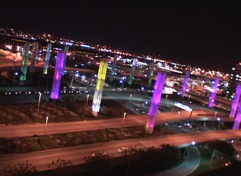 Traffic travels along city freeways Stock Video Footage