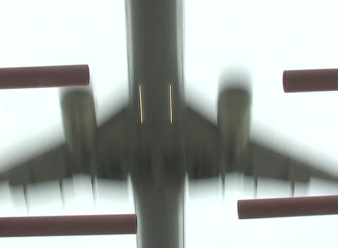An airplane flies over a metal grate Stock Video Footage