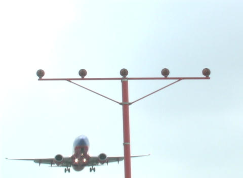 A jet flies low over landing lights Stock Video Footage