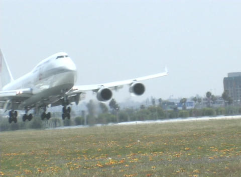 A jet makes a smooth landing along the runway Stock Video Footage