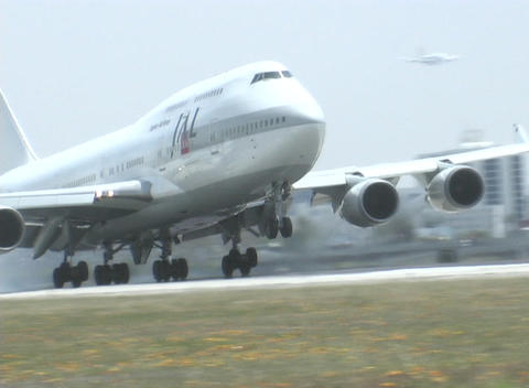 A jet makes a smooth landing along the runway Footage