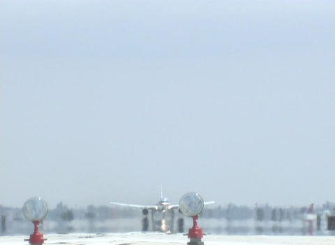 A jet takes off from an airport runway Stock Video Footage