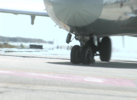 A passenger jet taxis on a runway Stock Video Footage