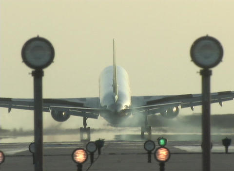 An airplane lands on a landing strip Stock Video Footage