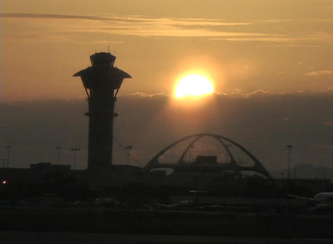 An airplane taxis at an airport during the golden hour Stock Video Footage