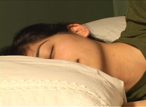 Time-lapse of sleeping woman reacting to light shining on... Stock Video Footage