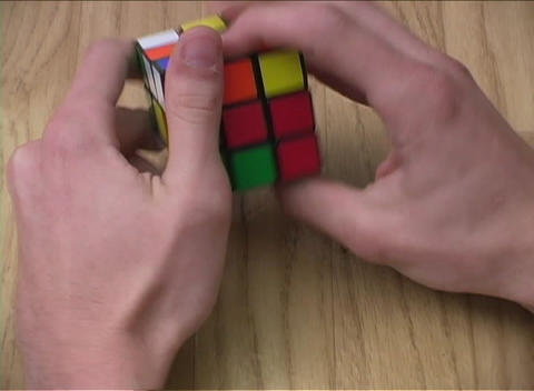 An accelerated view of a person conquering a Rubik's cube Stock Video Footage